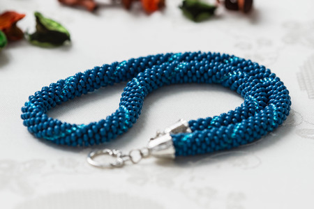 beaded: Handmade beaded necklace blue color close up Stock Photo