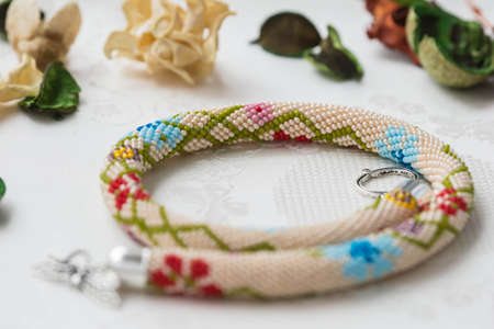 beaded: Beaded crochet necklace with floral pattern close up Stock Photo