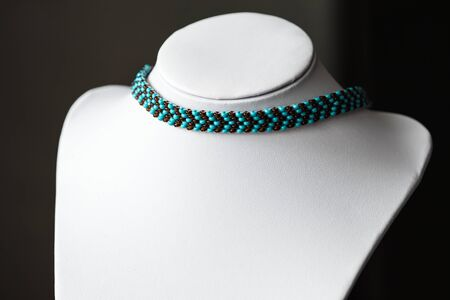 choker: Thin choker necklace of beads of two colors Stock Photo