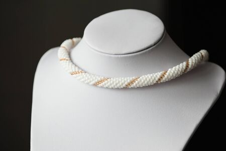 beaded: Beaded necklace from beads of white and golden color