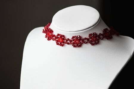 choker: Choker necklace in the shape of flowers in red Stock Photo