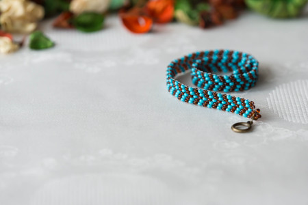 wattled: Wattled necklace from beads of turquoise and brown color Stock Photo