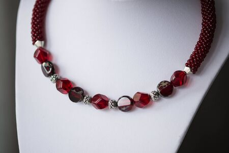 choker: Fragment of choker necklace made from beads and beaded rope