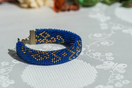 beaded: Beaded crocheted bracelet with oriental ornaments blue with golden