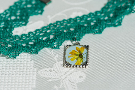 epoxy: ?hoker necklace from lace and pendant with natural flowers Stock Photo