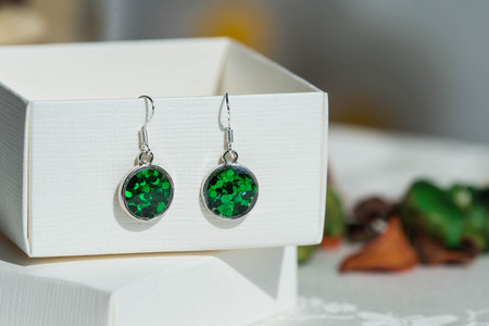 epoxy: Earrings made of epoxy resin and glitters close up