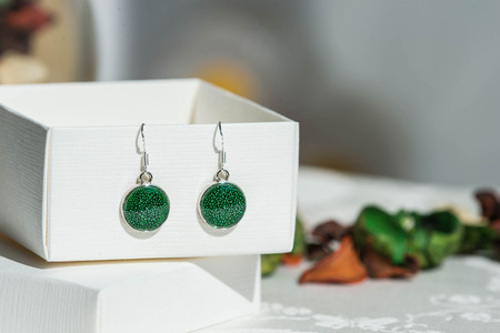 Earrings made of epoxy resin and glitters close up Banco de Imagens - 58144253
