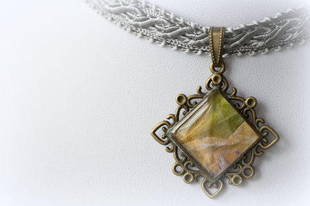 Choker-necklace with a bronze pendant made of epoxy resin and maple leaves