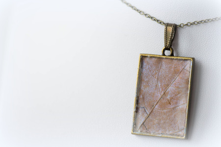 epoxy: Pendant made of dry maple leaves and epoxy resin