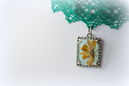 choker: Pendant with natural flowers on the lace choker close up