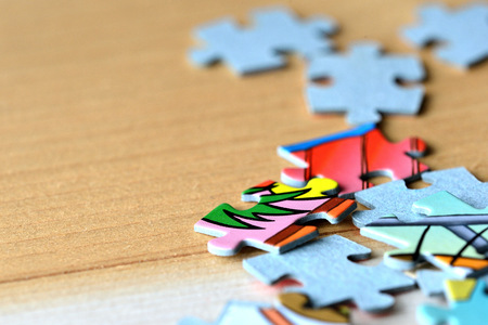 coincidence: Childrens puzzles on a wooden background close up