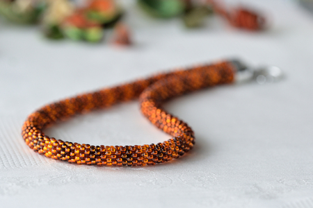 beaded: Beaded Crochet Necklace from amber color beads