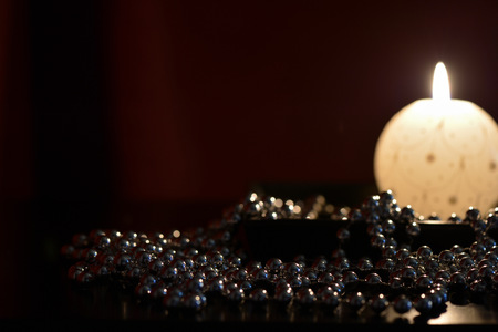 tranquillity: Burning candle and Christmas decorations in the dark