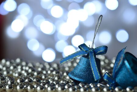 light chains: Blue bells and Christmas decorations with bokeh background Stock Photo