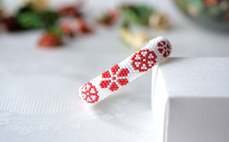 beaded: Beaded crochet bracelet with floral print close up Stock Photo