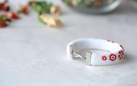 Beaded crochet bracelet with floral print close up Stock Photo