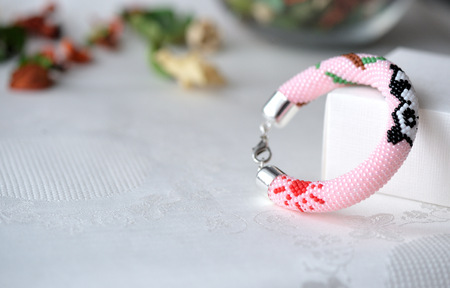 beaded: Pink beaded bracelet with the image of a panda close up