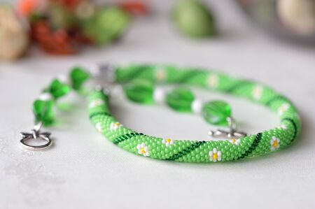 Beaded crochet choker necklace with flower print close up Stock Photo