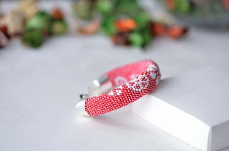 Red beaded crocheted bracelet with floral print
