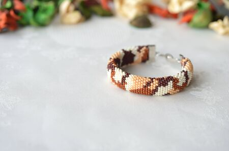 Bracelet in the style of desert camouflage close up