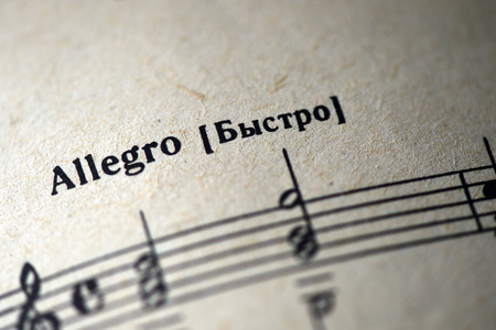 allegro: Musical tempo Allegro in a music notebook close up Stock Photo