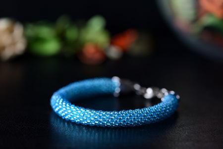 Turquoise beaded bracelet on a dark background