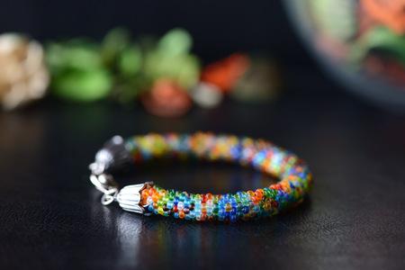 Colorful bead bracelet on a dark background