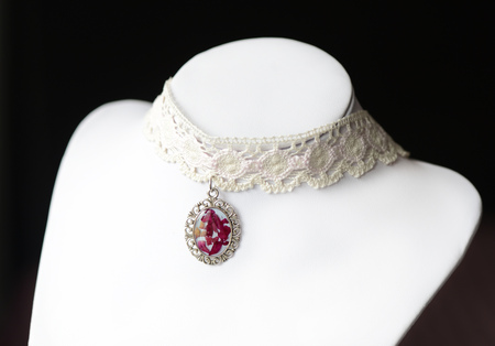 epoxy: Lace choker with a pendant made of epoxy resin and rose petals Stock Photo