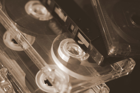 Some old audio cassettes on a dark background