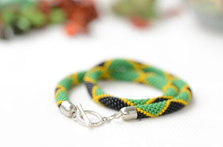 smooth: Bead crochet necklace in jamaican style close up Stock Photo