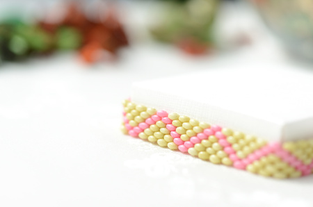 Beaded anklet light green and pink color close up Stock Photo