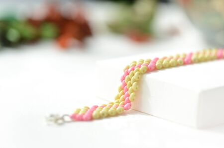 Beaded anklet light green and pink color close up Stok Fotoğraf