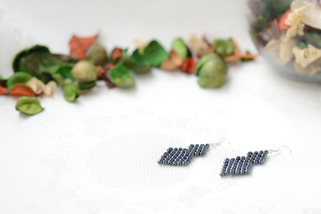 Black beaded earrings hematite color close up Stock Photo