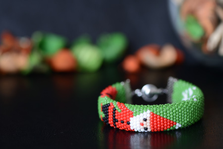Green Christmas bracelet with image of Santa close up
