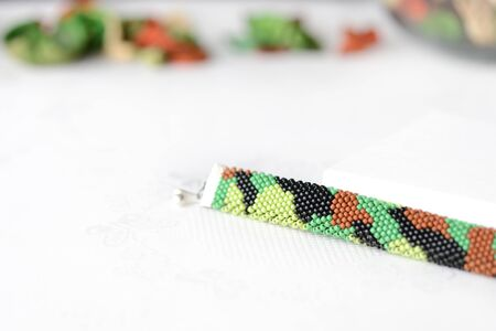 Bead crochet bracelet in military style, camouflage coloring