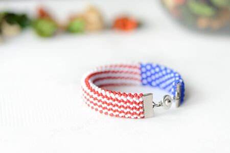 Bead crochet bracelet in colors of american flag close up Stock Photo