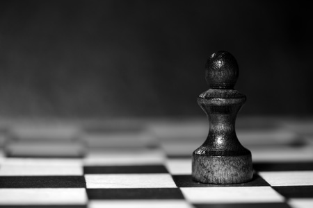 Chess figure on a chessboard. Black and white