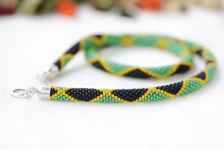 Bead crochet necklace in colors of Jamaican flag close up