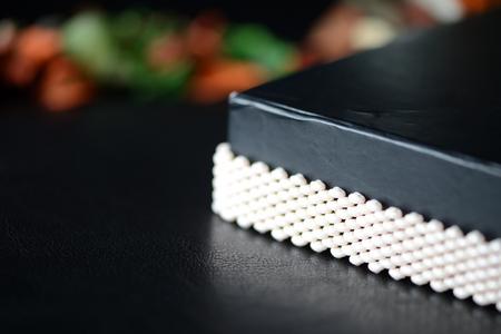 Beige beaded bracelet on a darck background close up