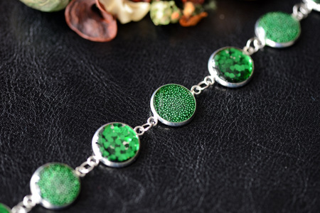 Green resin bracelet on a dark background close up
