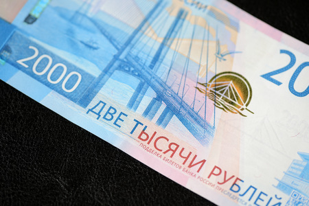Russian banknote in two thousand rubles on a dark background close up