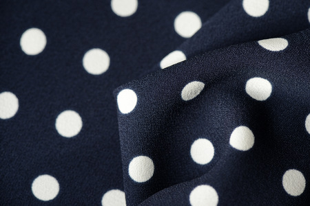 Blue and white polka dot textile background close up Stock Photo