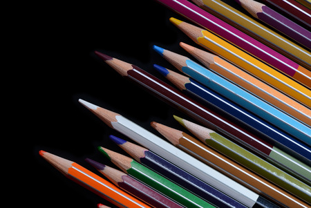 A pack of multicolored pencils on a dark background close up Stock Photo