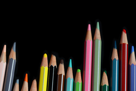 A pack of multicolored pencils on a dark background close up Foto de archivo