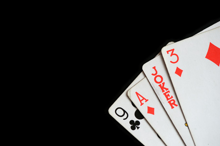 Several playing cards on a dark background close up