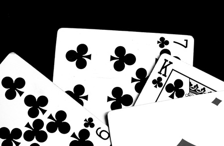 Playing cards on a dark surface close up. Black and white