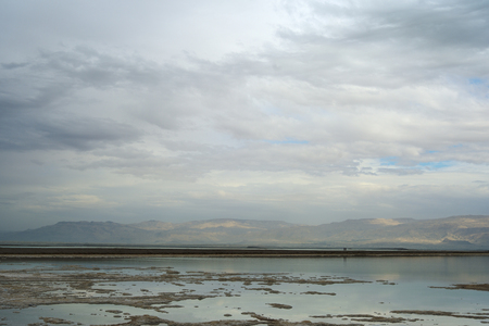 Dead Sea and overcast sky in cloudy weather