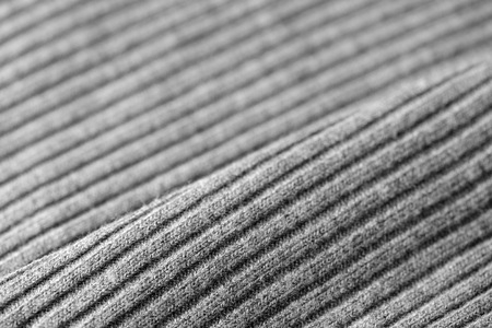 Gray knitwear as a texture and background close up