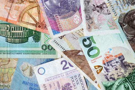Different countries money background close up. Belarusian rubles, Georgian lari, Polish zloty, Israeli shekels, Vietnamese dongs