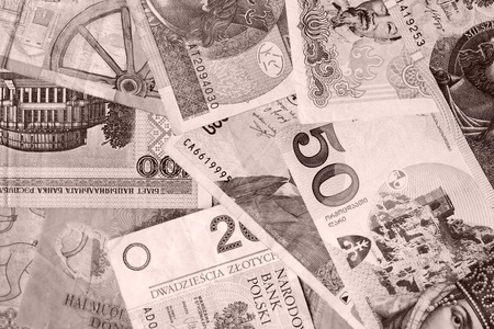 Different countries money background close up. Brown color toned